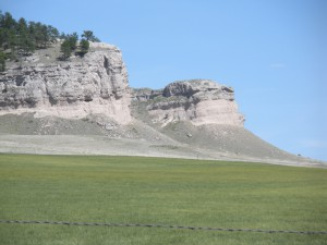Sandstone bluffs of the Miocene Harrison Formation overlie finer grained sediments of the Monroe Creek Formation in this impressive escarpment on the south flank of Slim Butte in the southwestern portion of the Pine Ridge Indian Reservation, South Dakota. The White Clay Fault occurs just to the south of these bluffs. All photos by Foster Sawyer.